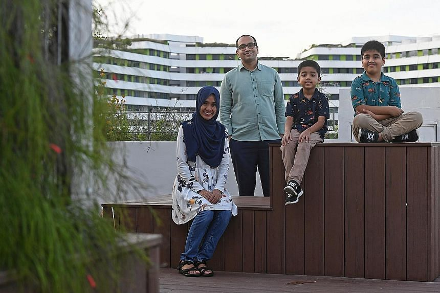 Mr Mohamed Sirajudin Mohamed Salman (with his wife Nadleen Mohamed Shariff) finds teachable moments to guide his sons, Mohamed Husain Mohamed Sirajudin (far right), seven, and Mohamed Hasan Mohamed Sirajudin, six, to embrace different cultures.