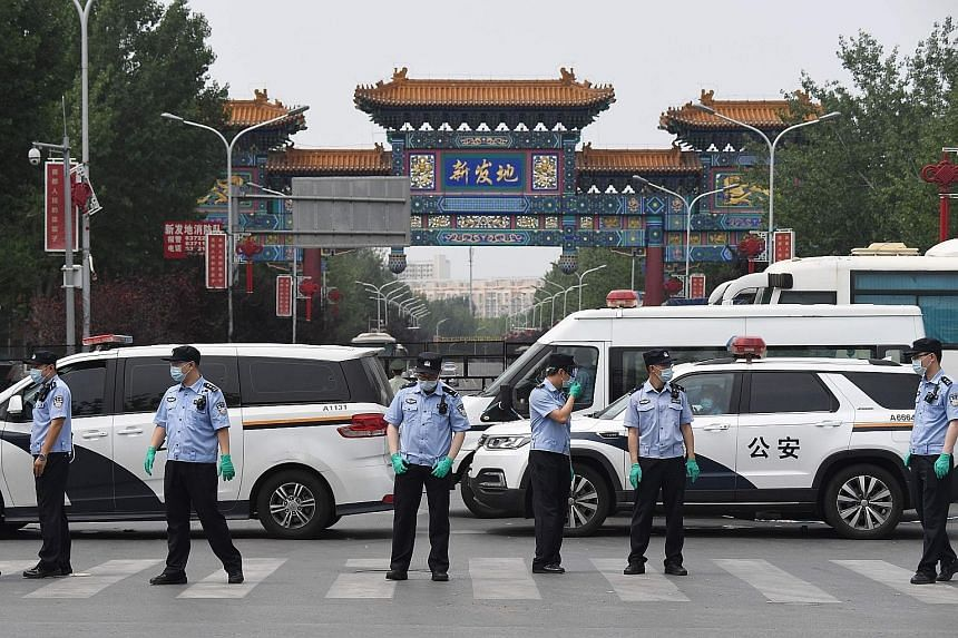China reports 57 new virus cases as Beijing cluster grows
