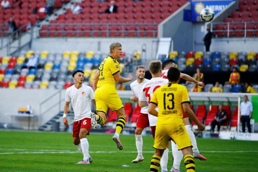 Haaland late show keeps Borussia Dortmund's slim title hopes alive