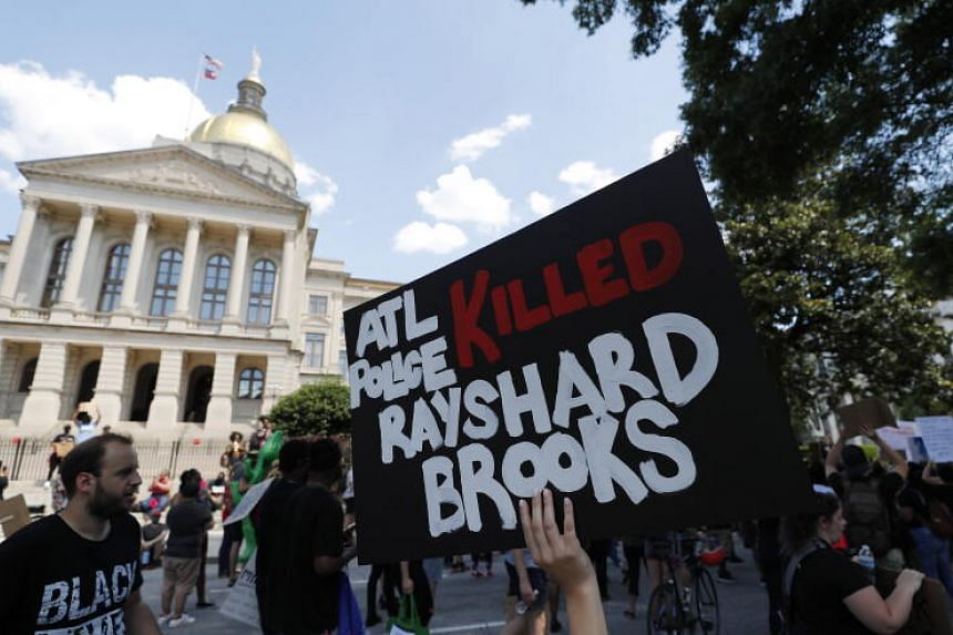 Protesters march near the Georgia Capitol on June 13, 2020.