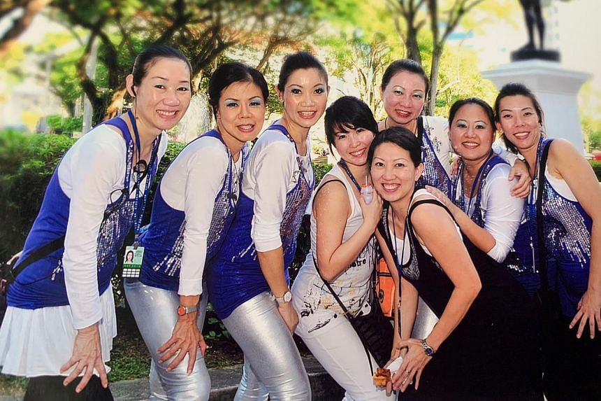 Ms Lee Toh Ling (left) with fellow NDP 2010 participants. She was first involved as a performer in 1995 and 2000, and subsequently as a trainer. Her last NDP was in 2015.
