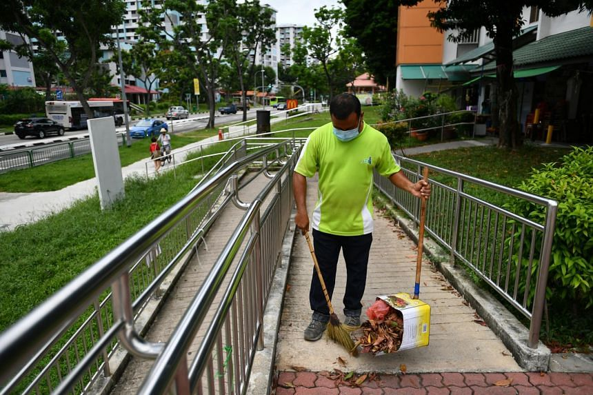A cleaner sweeping near Block 448 Ang Mo Kio Avenue 10, on May 28, 2020.