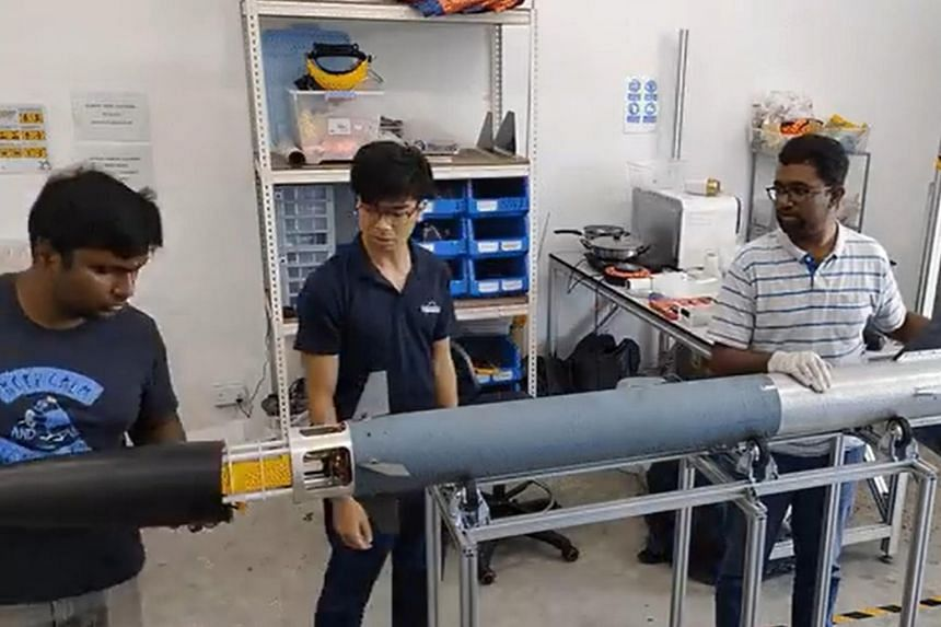 Staff from Equatorial Space Industries working on its Low Altitude Demonstrator guided rocket. The tech start-up, together with space burial firm Empyrean Space, is also developing rockets for space memorial flights.
