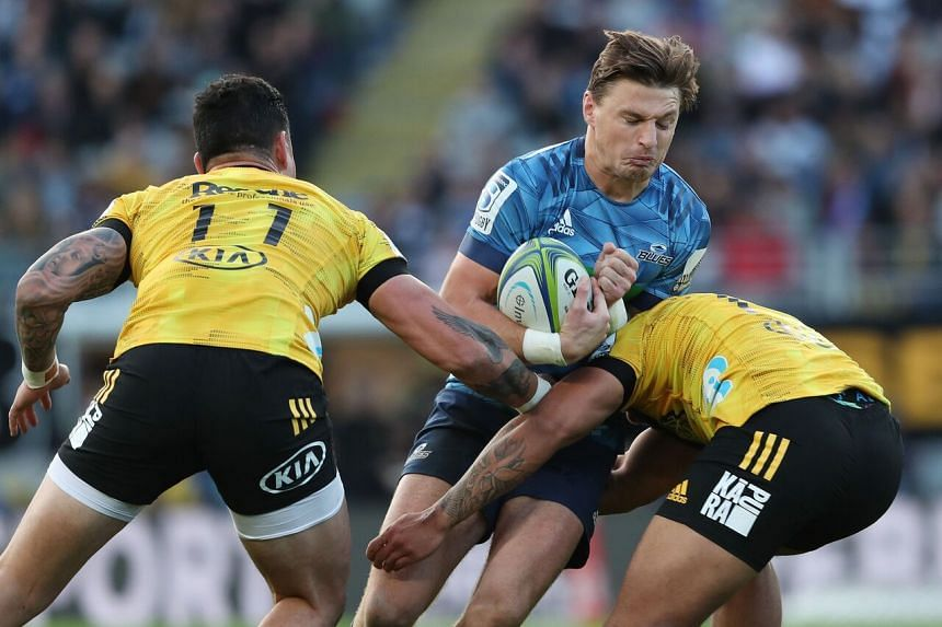 Beauden Barrett of the Auckland Blues is tackled during the Super Rugby match against the Wellington Hurricanes in Auckland on June 14, 2020.