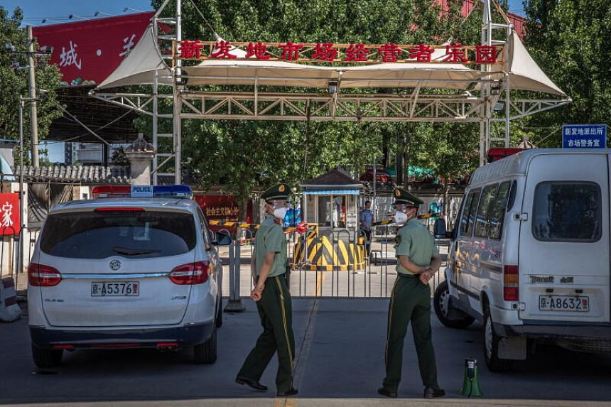 Chinese paramilitary police officers standing guard next to the closed Xinfadi market, in Fengtai district, Beijing, on June 14, 2020.