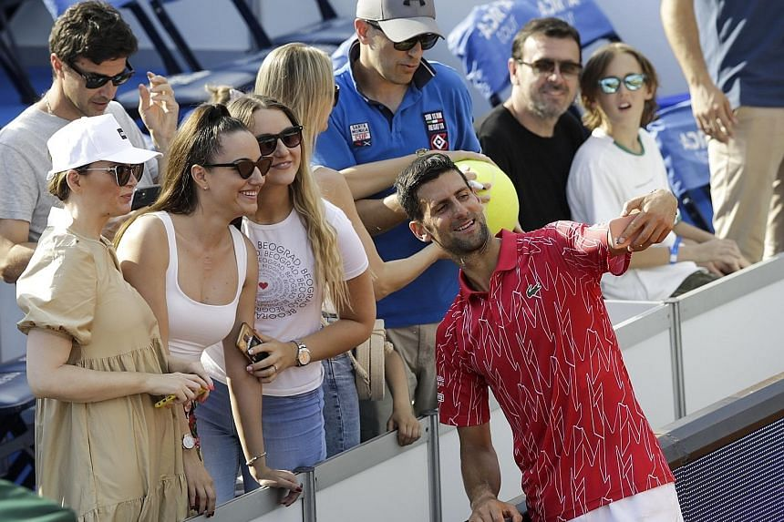 Hugs, slaps and little distance on Djokovic's tour