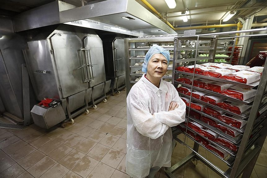 Mr Johnson Tay, director of operations at Sin Mui Heng Food Industries, in a 2019 file photo. The food manufacturer's management was quick to realise that the only source of income during the outbreak would be from direct consumers so it continued or