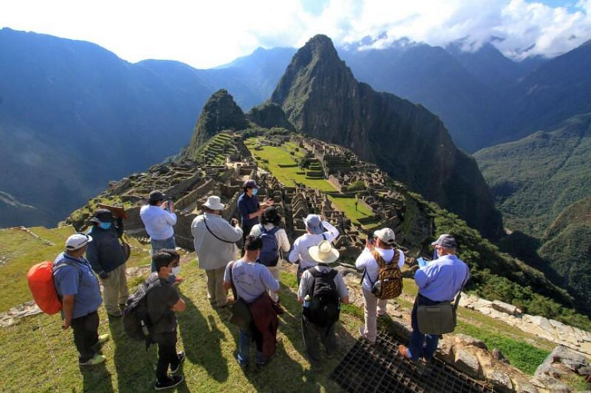 Members of a commission of authorities and experts visit the Inca citadel of Machu Picchu, on June 12, 2020.