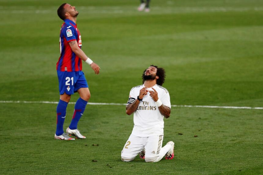 Real Madrid's Marcelo celebrates after the match.