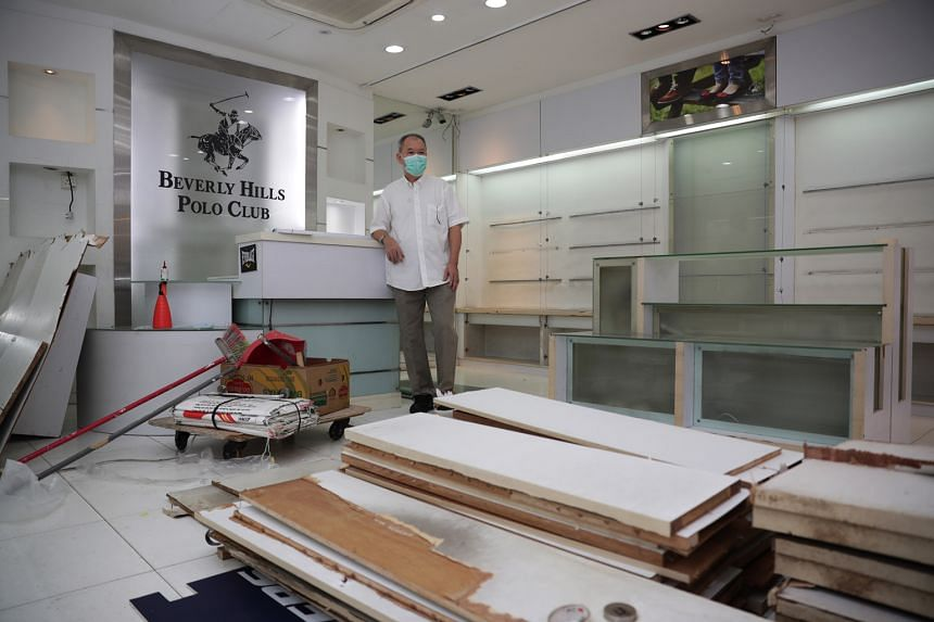 Landlord Wong Hin Yet said he is unable to collect rent as his shop space is unoccupied. The previous tenant vacated in April and the new tenant is unable to take over as the space has not been restored to its original condition. ST PHOTO: GIN TAY