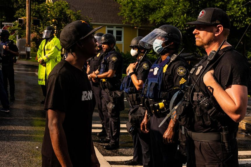 Protesters are met by police during a march in Atlanta on June 14, 2020.