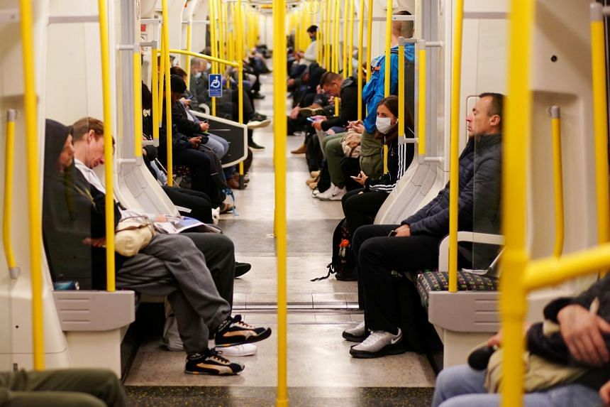 Commuters are seen on a London Underground train on June 10, 2020.