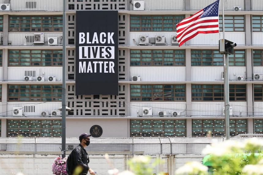 A banner supporting the Black Lives Matter movement hangs from the US embassy in Seoul on June 14, 2020.