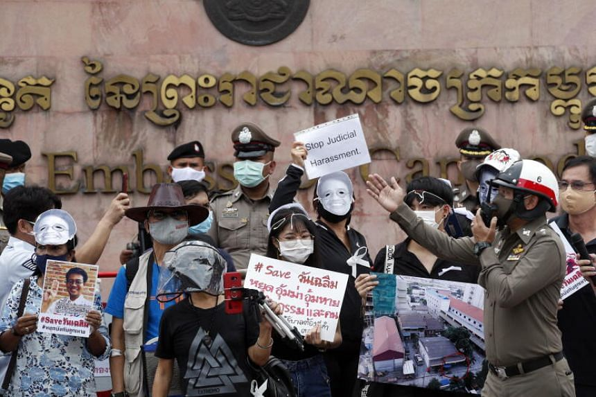 Thai police officers order people to leave a protest in Bangkok, on June 15, 2020.