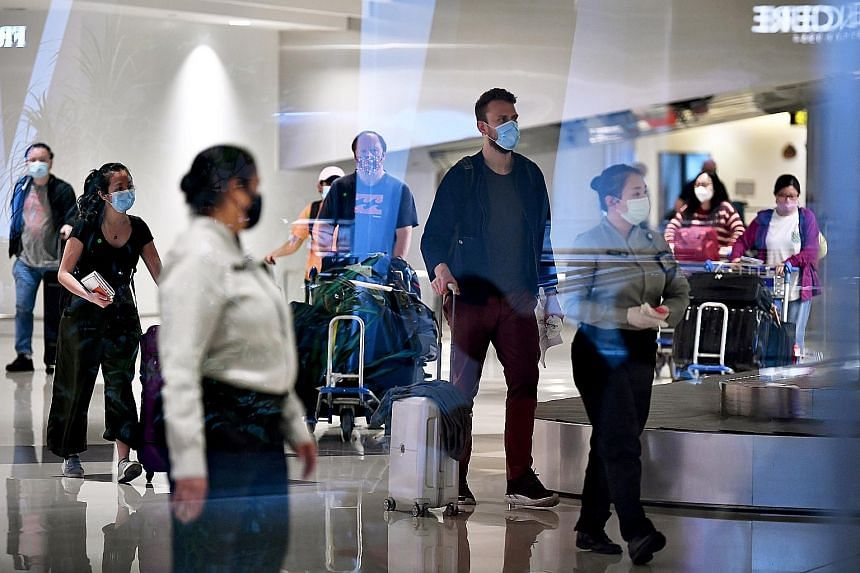 Passengers arriving at Changi Airport Terminal 1 last Friday. All travellers entering Singapore from 11.59pm on Wednesday will have to take a Covid-19 test before the end of their 14-day stay-home notice at a designated community testing facility. ST