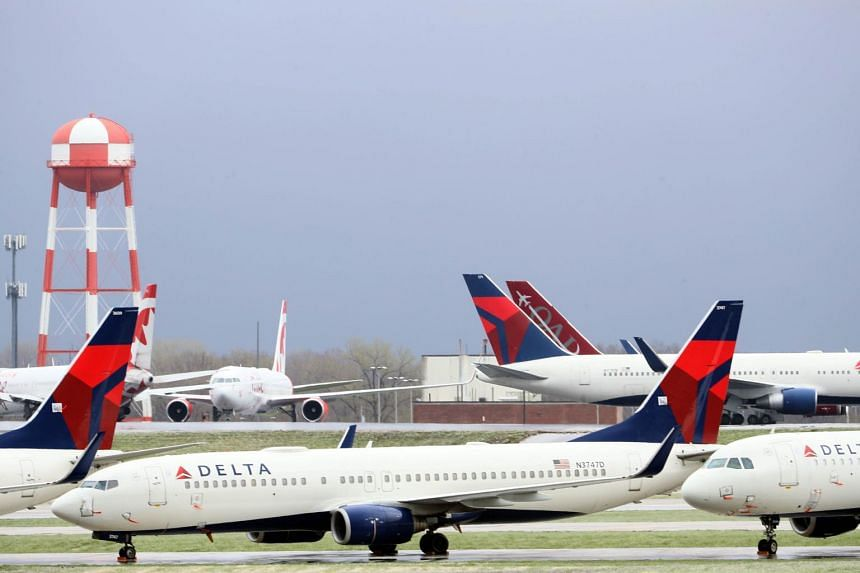 Planes belonging to Delta Air Lines sit idle at Kansas City International Airport on April 3, 2020.
