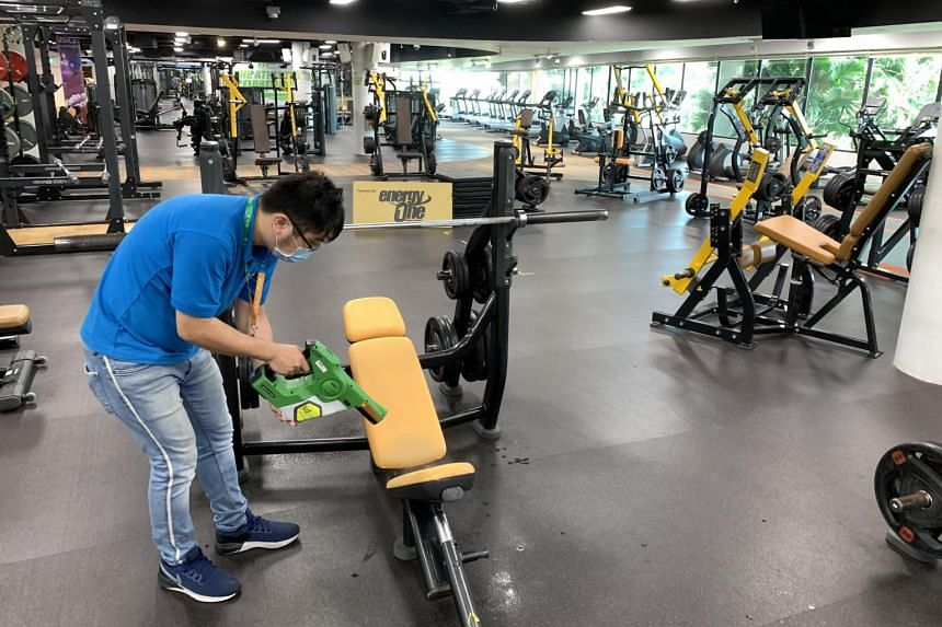Self-disinfecting coating being applied to equipment at EnergyOne gyms.