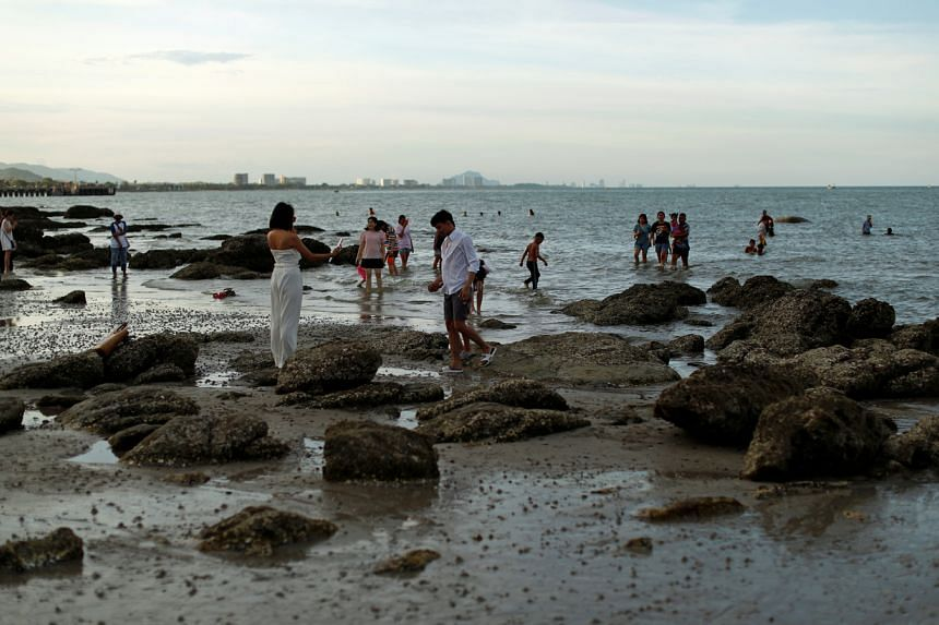 People are seen at a beach in Hua Hin, Thailand, on June 13, 2020.
