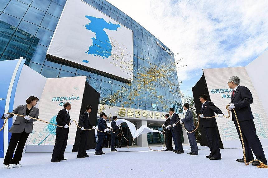 Above: South Korean and North Korean delegates taking part in an opening ceremony for the inter-Korean liaison office in Kaesong, North Korea, in September 2018. Left: A TV news report showing an explosion at the liaison office yesterday. North Korea