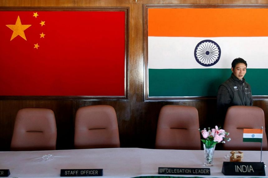 A man walks inside a conference room used for meetings between military commanders of China and India, in Arunachal Pradesh, India, on Nov 11, 2009.