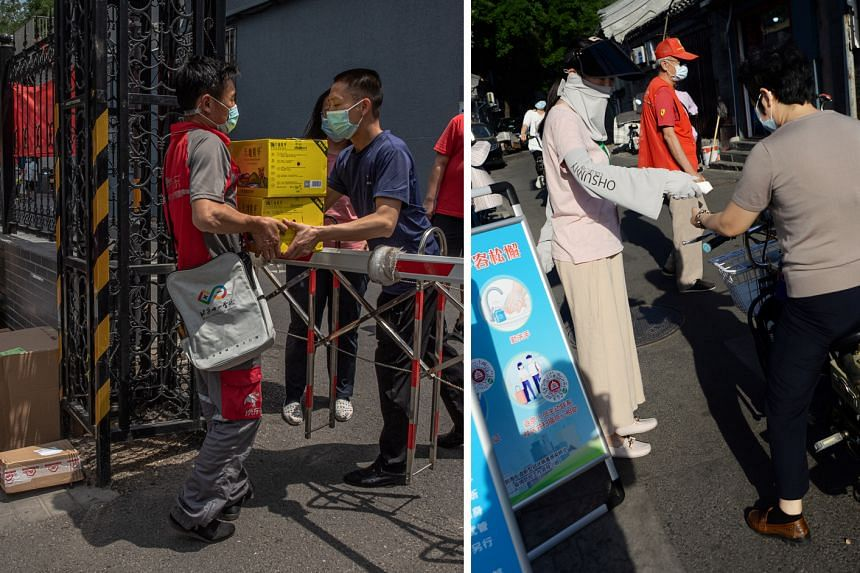 Left: A delivery man handing over packages for residents of a building near the Yuquandong market. Right: A health screener in improvised facial gear taking the temperature of an electric bicycle rider in Beijing yesterday.