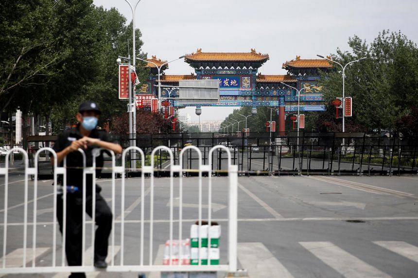 A security officer at a blocked entrance to the Xinfadi market in Beijing on June 16, 2020.
