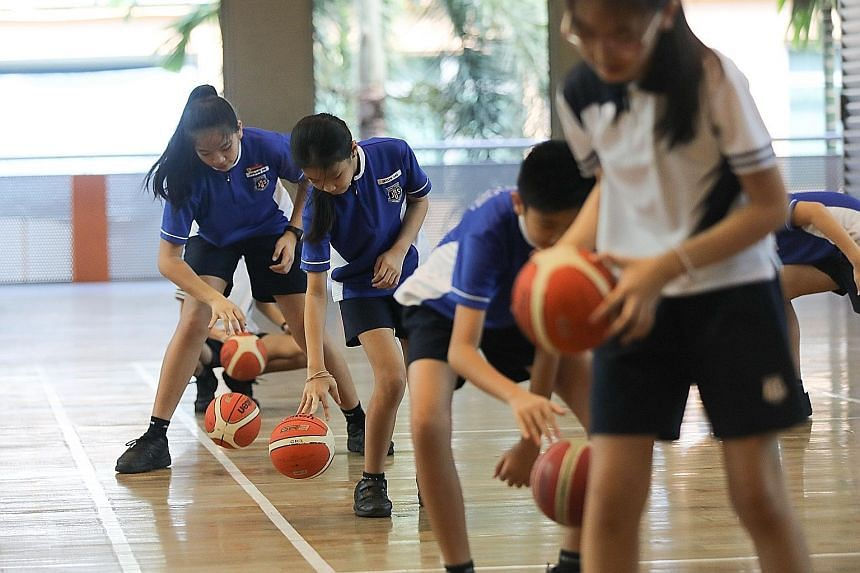 A physical education lesson at Jing Shan Primary School in which pupils have to observe social distancing. For PE lessons, schools will allow group activities and games that involve minimal physical contact or have a small number of players on each s