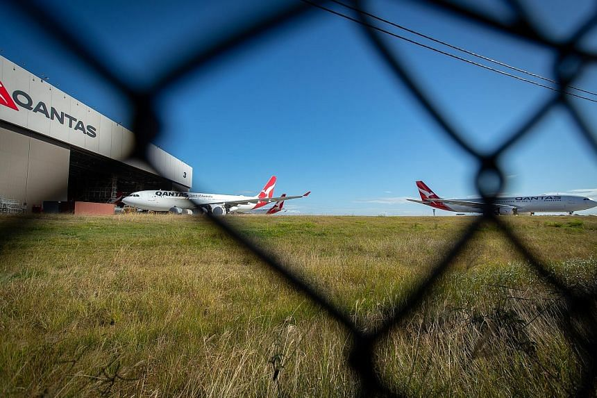 Grounded Qantas aircraft outside a hangar at Brisbane Airport on June 9. Australia has been largely successful in containing the spread of the novel coronavirus, which it attributes to curbs on international travel and tough social-distancing rules.