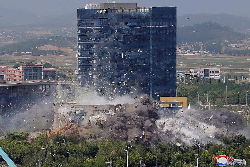The blast that destroyed the inter-Korean liaison office in the border city of Kaesong on the North's side of the demilitarised zone on Tuesday, in this picture supplied by the Korean Central News Agency. The South's military warned that the North wi