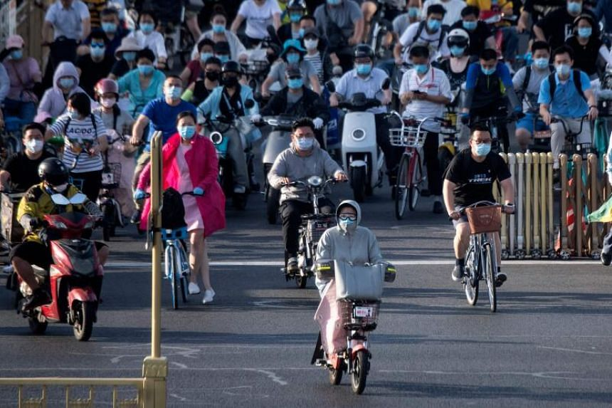People commute during rush hour in Beijing, on June 16, 2020.