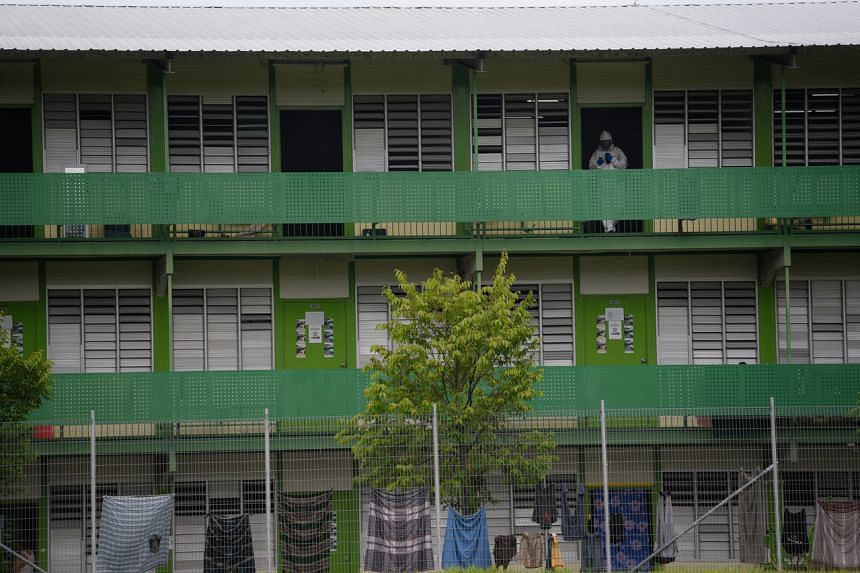 The majority of the Covid-19 cases here are work permit holders residing in foreign worker dormitories.