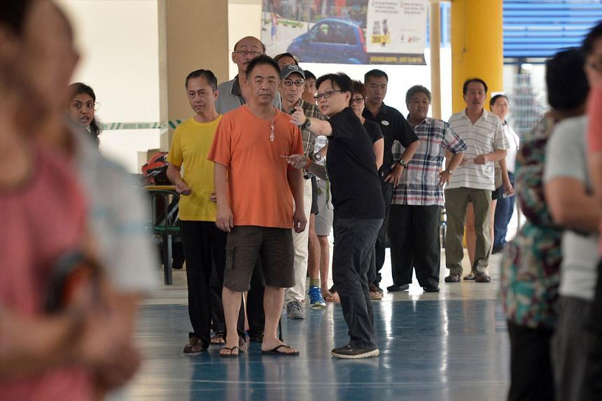 A photo taken on Sept 11, 2015, showing people waiting in line to cast their votes at Pei Chun Public School.