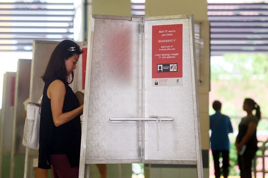 A photo taken on Sept 11, 2015, showing a woman casting her vote at Teck Ghee Primary School.