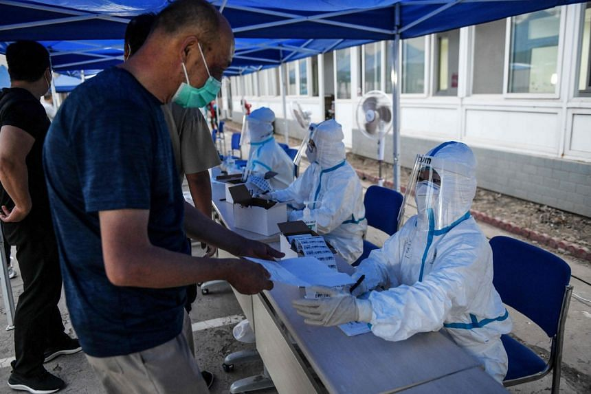 A man registers to undergo a swab test for the coronavirus at a testing center in Beijing, on June 17, 2020.