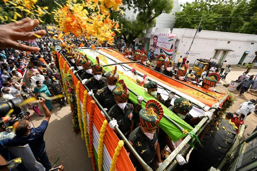 Soldiers carry the coffin of Colonel B.Santosh Babu on a truck during his funeral ceremony at his hometown in Suryapet, India, on June 18, 2020.