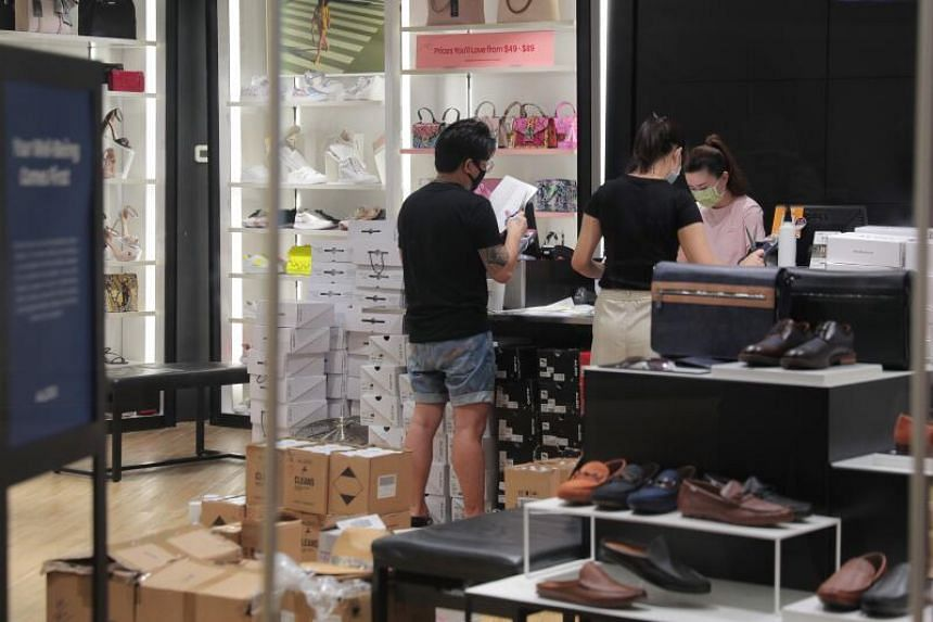 Staff working at the Aldo store in Ion Orchard on June 18, 2020.