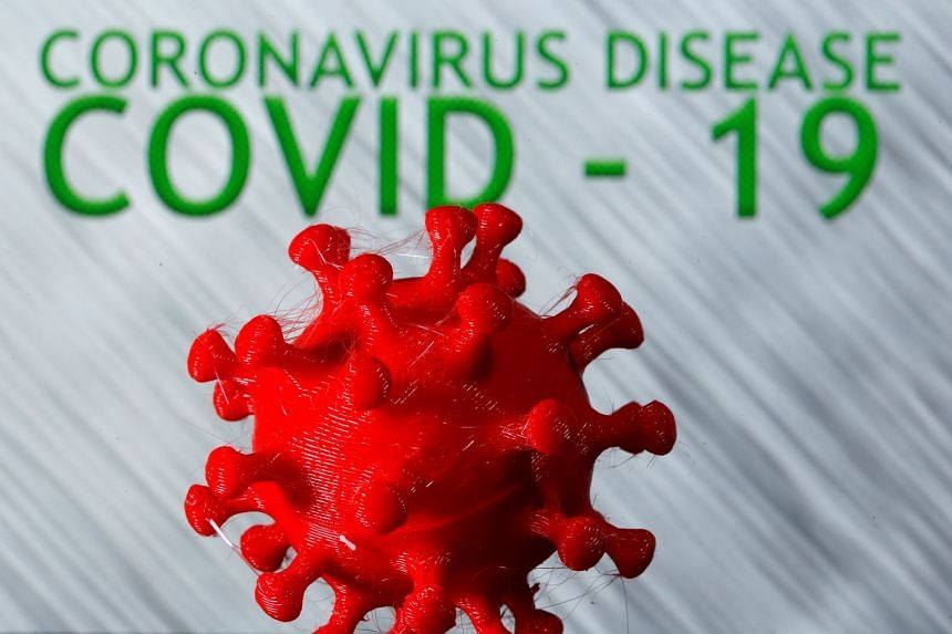A 3D-printed coronavirus model is seen in a photo illustration.