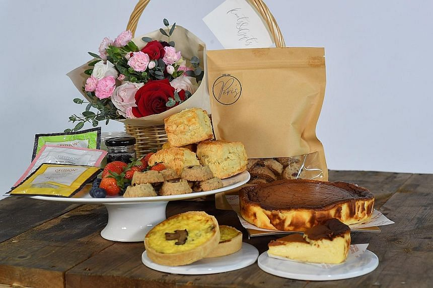 Knots & Gifts: The top-end bundle comes with a burnt cheesecake from Basque Kitchen by Aitor, quiches and scones from Patisserie G, cookies from Just Like Peri, Gryphon tea sachets and fresh berries.