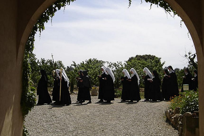 Benedictine nuns (above) of the Abbey of Notre-Dame de Fidelite of Jouques in Provence, France.