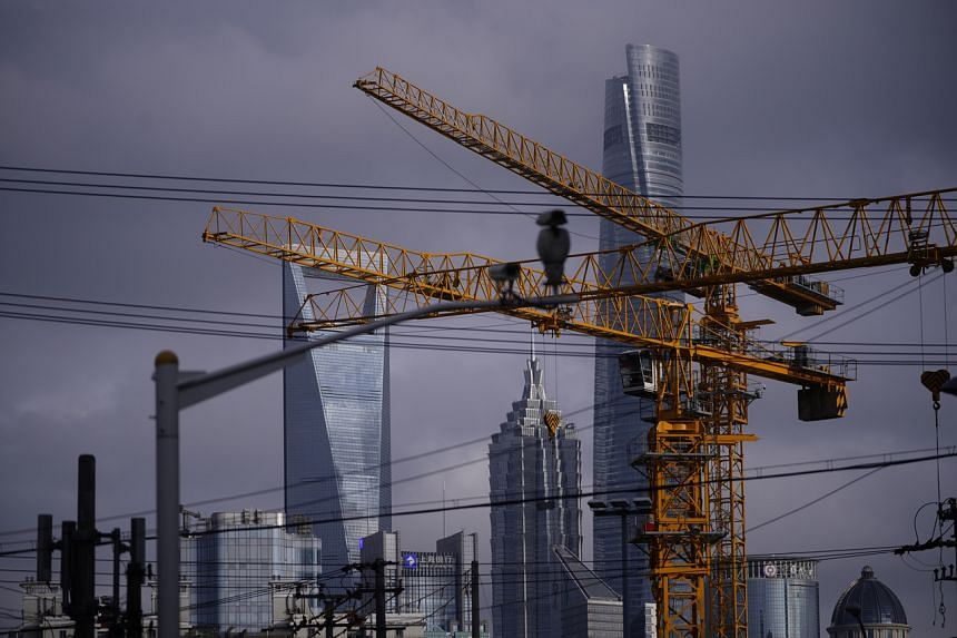 Cranes seen at a construction site in Shanghai on June 9, 2020.