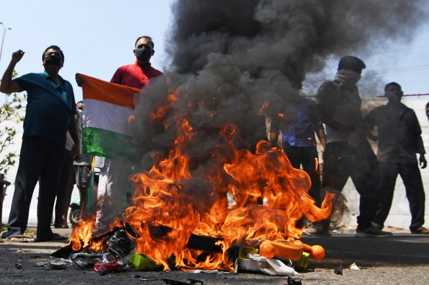 Protesters burn Chinese products in New Delhi on June 18, 2020.