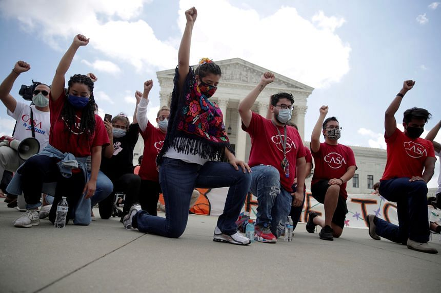 People take a knee in support of the Black Lives Matter movement outside the US Supreme Court in Washington, on June 18, 2020.
