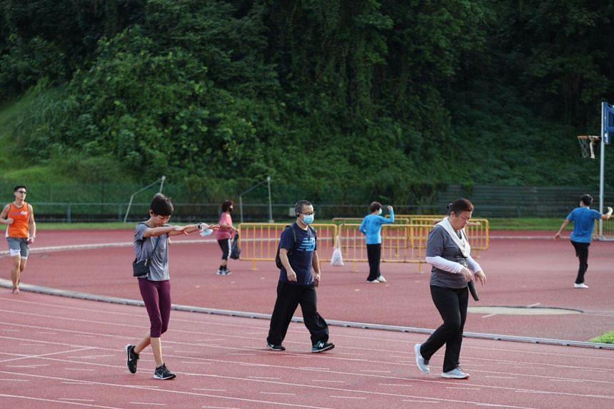 People exercising at Bukit Gombak Stadium on June 19, 2020.