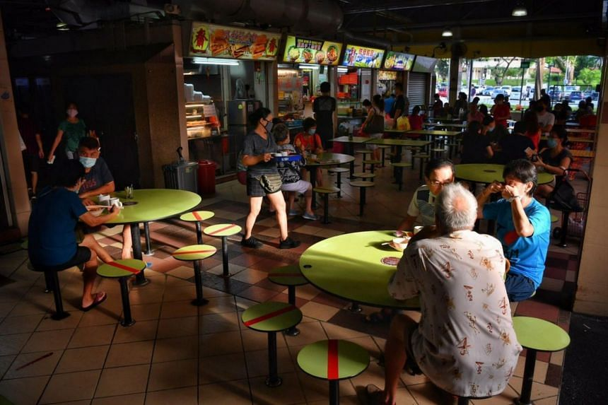 People eating at the Mayflower Hawker Centre on June 19, 2020.