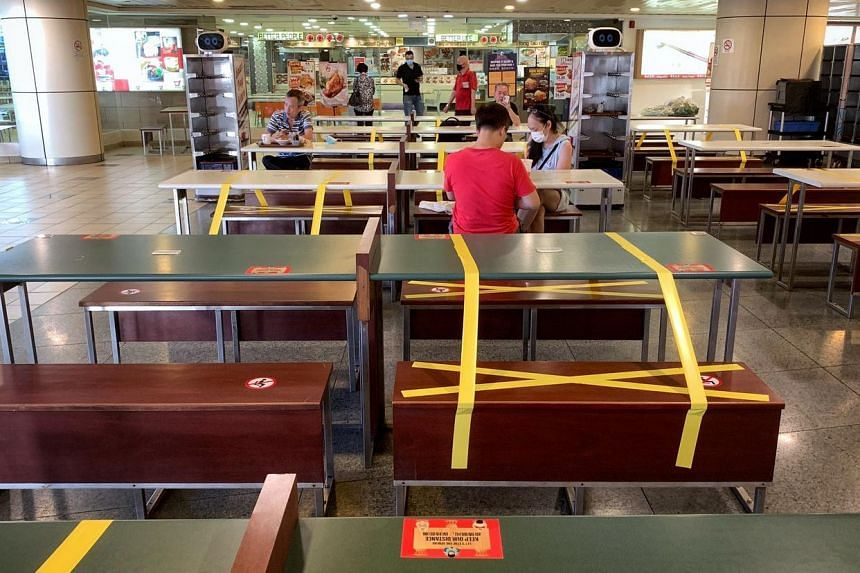 People having breakfast at Koufu  in Toa Payoh bus interchange on June 19, 2020.