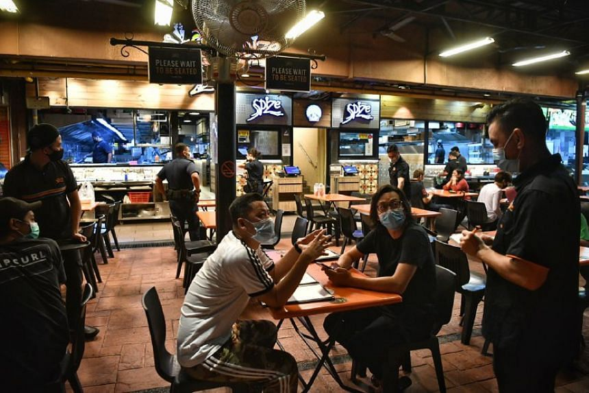 Patrons enjoying their meals in Simpang Bedok at midnight on June 18, 2020.
