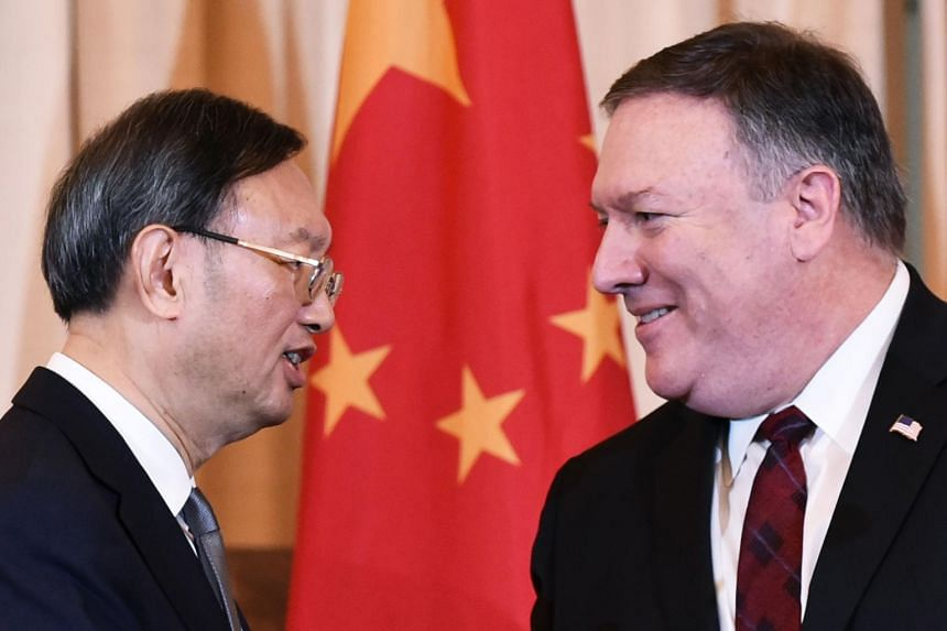 A photo taken on Nov 9, 2018, shows US Secretary of State Mike Pompeo (right) and Chinese diplomat Yang Jiechi in Washington, DC.
