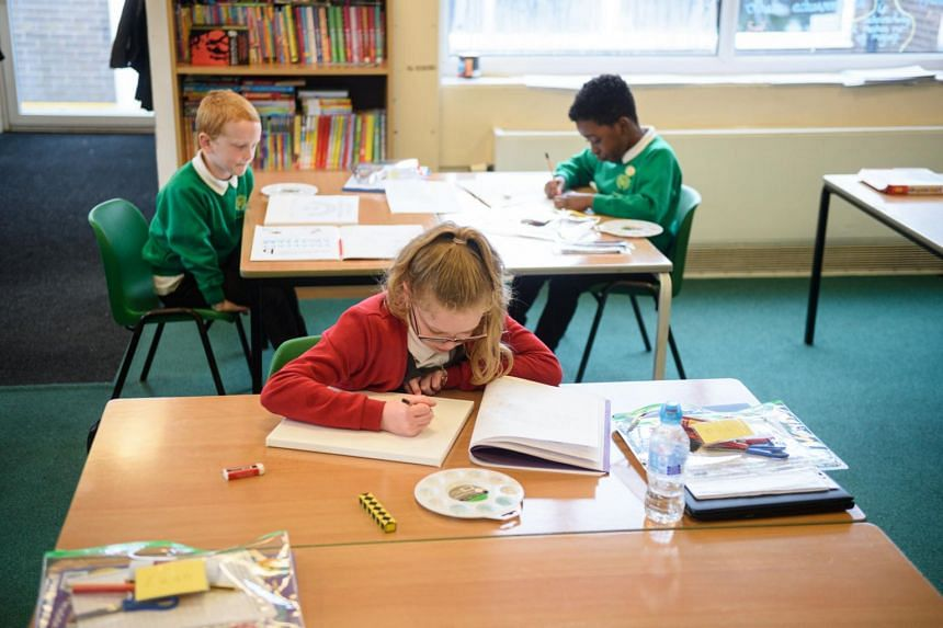 Pupils work on a task at a primary school in Oldham, northern England, on June 18, 2020.