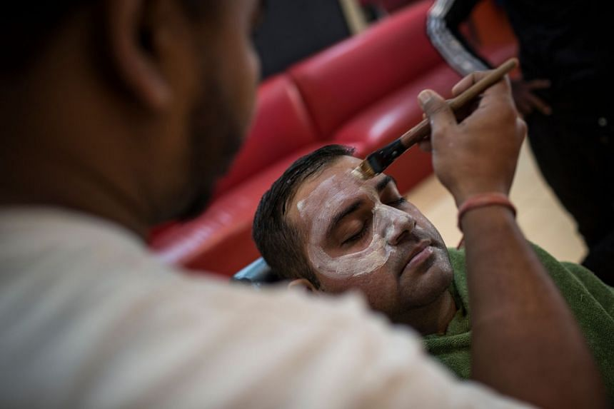 A 2018 photo shows a man undergoing a skin lightening facial at a salon in South Africa.