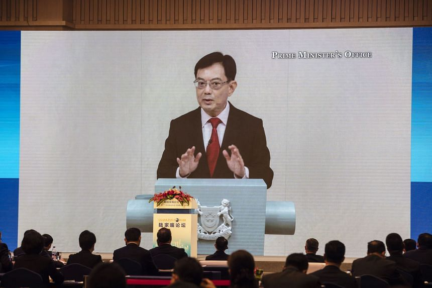 Deputy Prime Minister Heng Swee Keat speaking via video link at the 12th Lujiazui Forum in Shanghai yesterday. The annual forum was held virtually for the first time, with Singapore as the partner city this year.